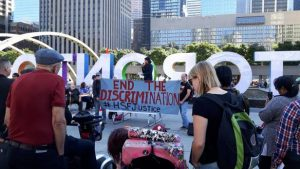"""HSF Justice rally in Nathan Phillips Square. Banner reads: """"End the Discrimination #HSFJustice"""""""
